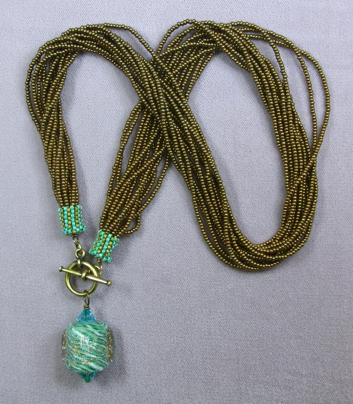 Multistrand Necklace with Unicorne Focal Bead